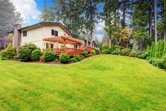 House with backyard landscape Stock Photos