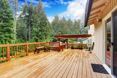 walkout deck overlooking backyard landscape - stock photo
