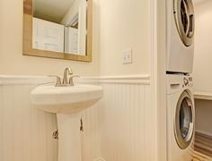 Bathroom with washer and dryer Stock Photos