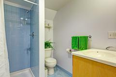 Stock Photo of simple bathroom interior in light blue tones