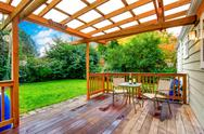 Stock Photo of house exterior. backyard walkout deck