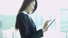 Female Asian Chinese Stock Broker Mini Tablet Close Up - stock footage