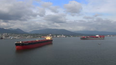 Two big cargo ships in port - Vancouver harbor Stock Footage