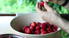 Strawberries.  Man prepares strawberries. 1 Stock Footage