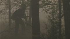 Lone soldier walks through foggy woods Stock Footage