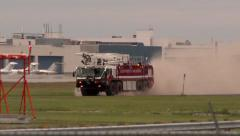 Airport fire truck driving fast along runway and near the camera Stock Footage