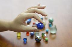 Hand holding glass marble balls Stock Photos