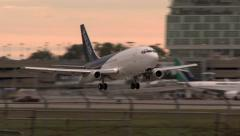 Airplane in distress is landing and followed by airport firetrucks Stock Footage