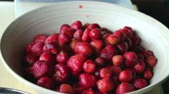 Strawberries.  Man prepares strawberries. 2 Stock Footage