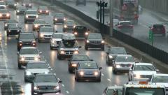 Multiple cars driving slowly in traffic jam on highway in angled closeup - stock footage