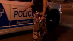 Police officers wear camo style pants as a mesure of protest - stock footage