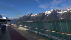 Cruise ship floating among snowy mountains - Alaska - stock footage