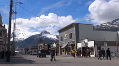 Alaskan city, cityscape with snowy mountains background - Skagway, Alaska Stock Footage