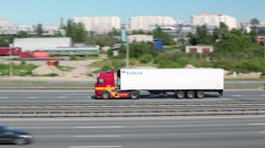 Stock Video Footage of Cargo truck red cabin driving on the motorway. The Ring Road