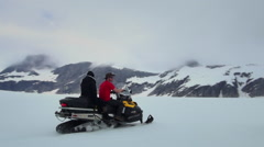 Snowmobile on snow field - Alaska, two footage Stock Footage