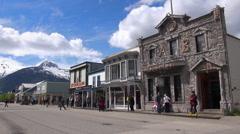 Alaskan city, cityscape with snowy mountains background - Skagway, Alaska Stock Footage