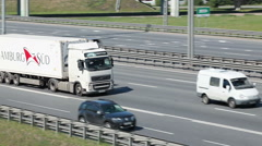 Cargo truck driving on the highway. Camera tracking Stock Footage