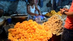 Wide shot of Jalebi seller in an Indian Village fair Stock Footage