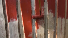 Paint wooden farm barn wall with paint roller Stock Footage