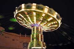 Merry go round in the amusement park Kuvituskuvat