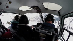 View from inside a flying helicopter - flight over of snowy mountains Stock Footage