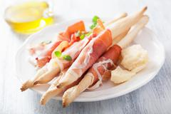 Prosciutto ham and grissini bread sticks. italian antipasto Stock Photos