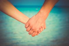 two people's hands - stock photo