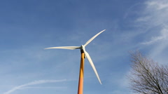Brightly colored wind turbine Stock Footage
