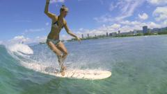 Slow Motion Woman Surfer Riding Ocean Wave Stock Footage