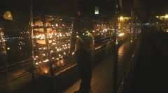 People lighting candles in the Temple of the Tooth, a Buddhist temple. Stock Footage