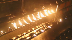 Burning candles in the Temple of the Tooth. Stock Footage