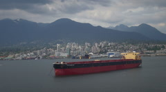 Aerial shot of big container ship - Vancouver harbour, Canada Stock Footage