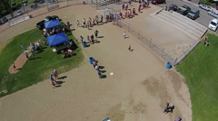 Aerial annual town festival at ball park HD 130 Stock Footage