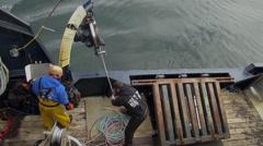 Alaskan crab fishing boat - windlass working, two footage Stock Footage