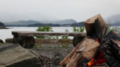 Camp fire with mountains background - Alaska Stock Footage