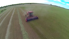 Aerial shot of Red Swather Cutting Hay 5 Stock Footage