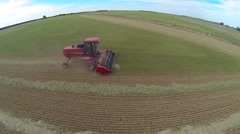Aerial shot of Red Swather Cutting Hay 6 Stock Footage