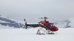 Helicopter parking on the glacier snow field - Alaska mountains Stock Footage