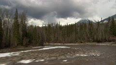 1080HD Cineflex shot down river in British Columbia with snow and trees Stock Footage