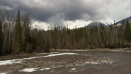 Stock Video Footage of 1080HD Cineflex shot down river in British Columbia with snow and trees