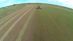 Aerial shot of Red Swather Cutting Hay 7 Stock Footage