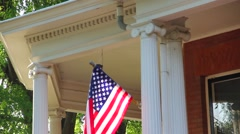 American Flag on Porch Stock Footage