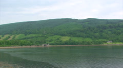 Loch Fyne at its head, two houses across the fjord Stock Footage