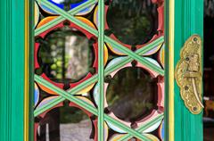 Temple door knob and wall patterns Stock Photos