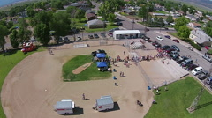 Aerial Community carnival festival starting at ball field HD 128 Stock Footage