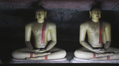 Two sitting Buddhas at the Golden Temple of Dambulla. Stock Footage