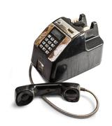 shabby outdated telephone - stock photo