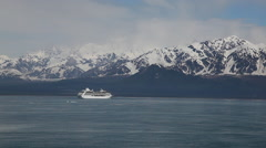 Cruise ship floating at icy ocean - snowy mountains background Stock Footage