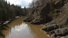 1080HD Cineflex low shot follows river in British Columbia Stock Footage