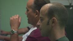 3 men in a row talking, side shot, office Stock Footage